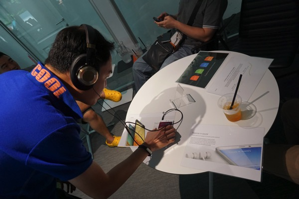 MiNote launch experiential event 2015 - testing out with headphones