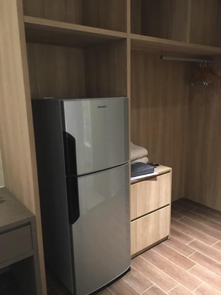 D'Resort - inside Park View room - fridge and open cabinet